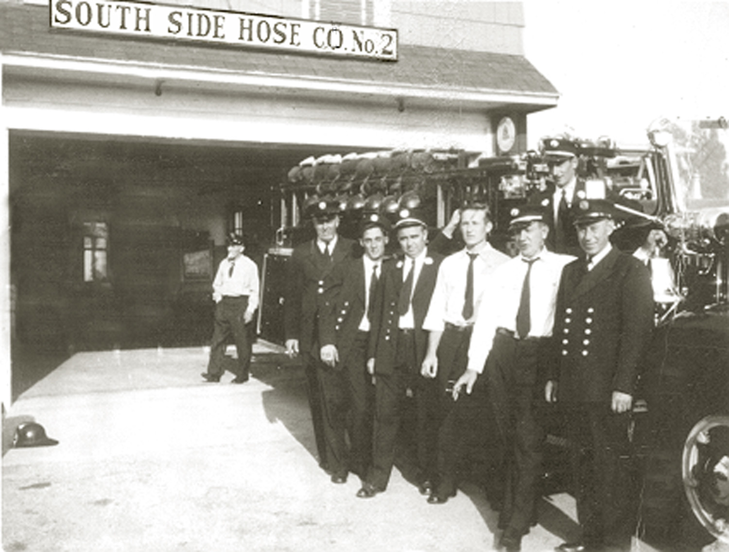 Members of Hose Company No. 2 in front of their original building in the 1950s.