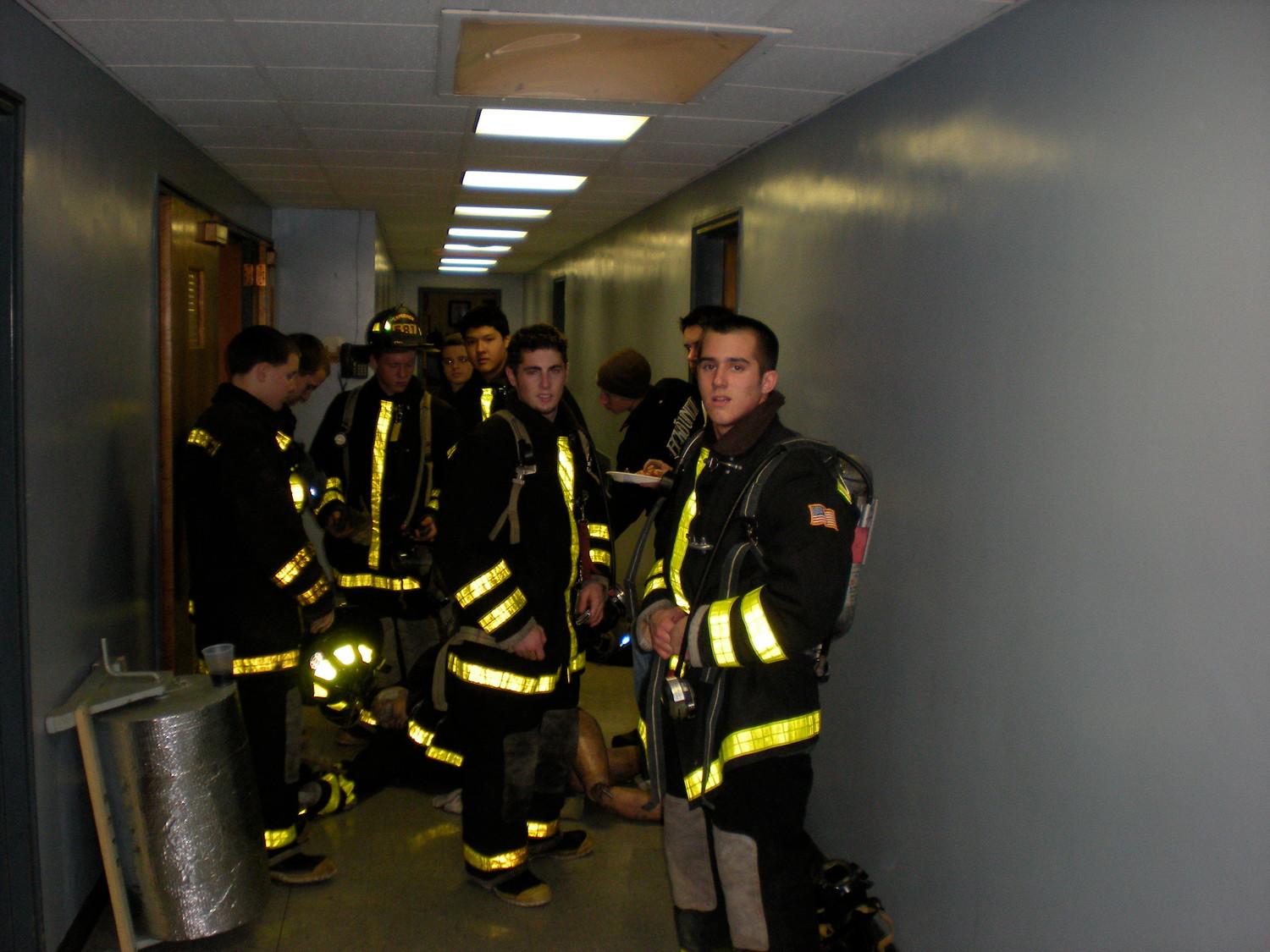 "Older Explorers practice rescue drills at the Nassau County Fire Service Academy's ""burn building"" in Old Bethpage."