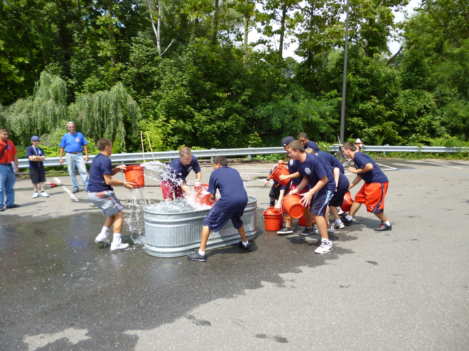 The Fire Explorers practice a number of firefighting skills, including the bucket brigade.