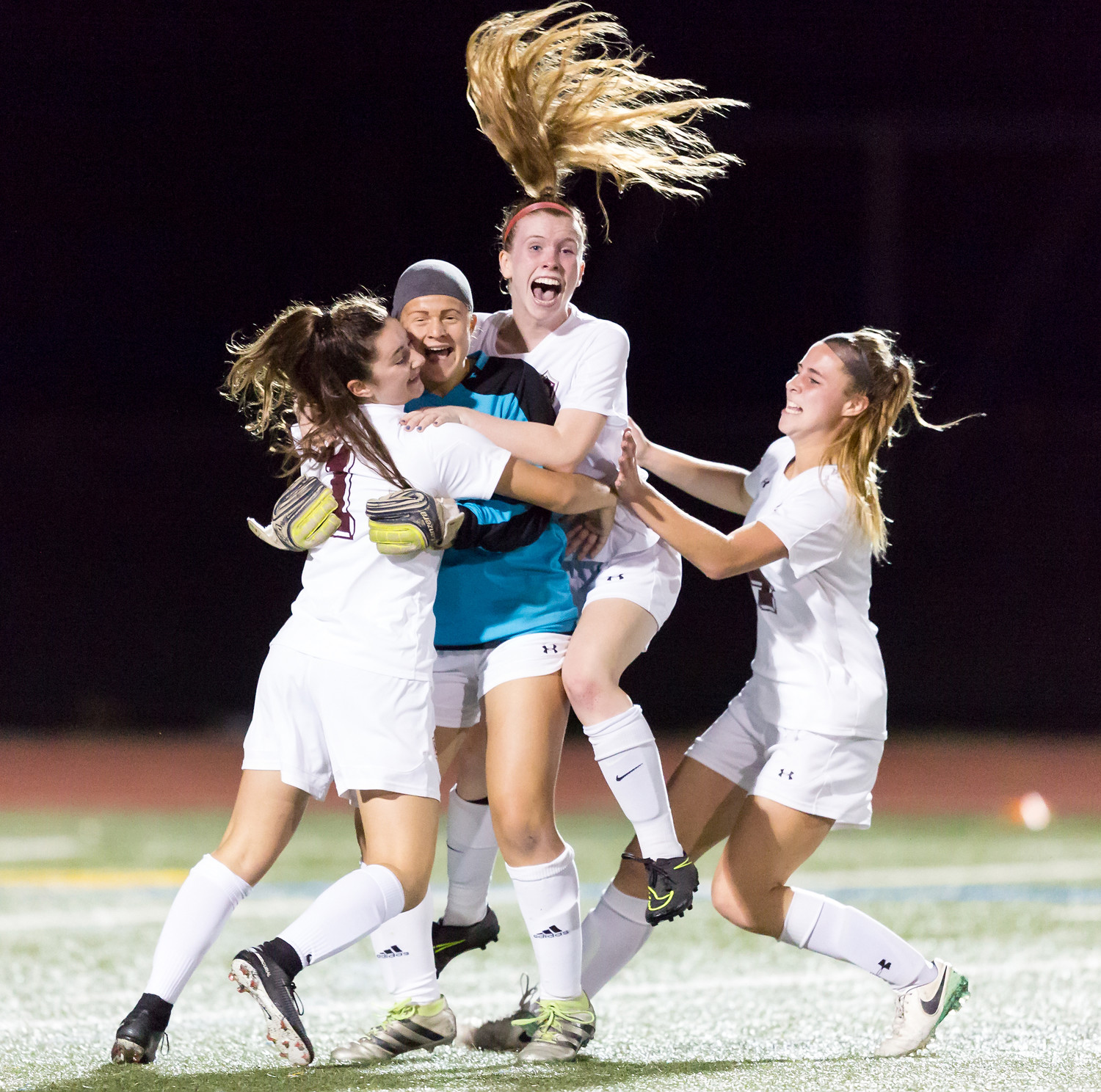 Freelancer John Heckman earned third place for Sports Feature Photo for this one of the North Shore High School girls' soccer team celebrating after a championship game.