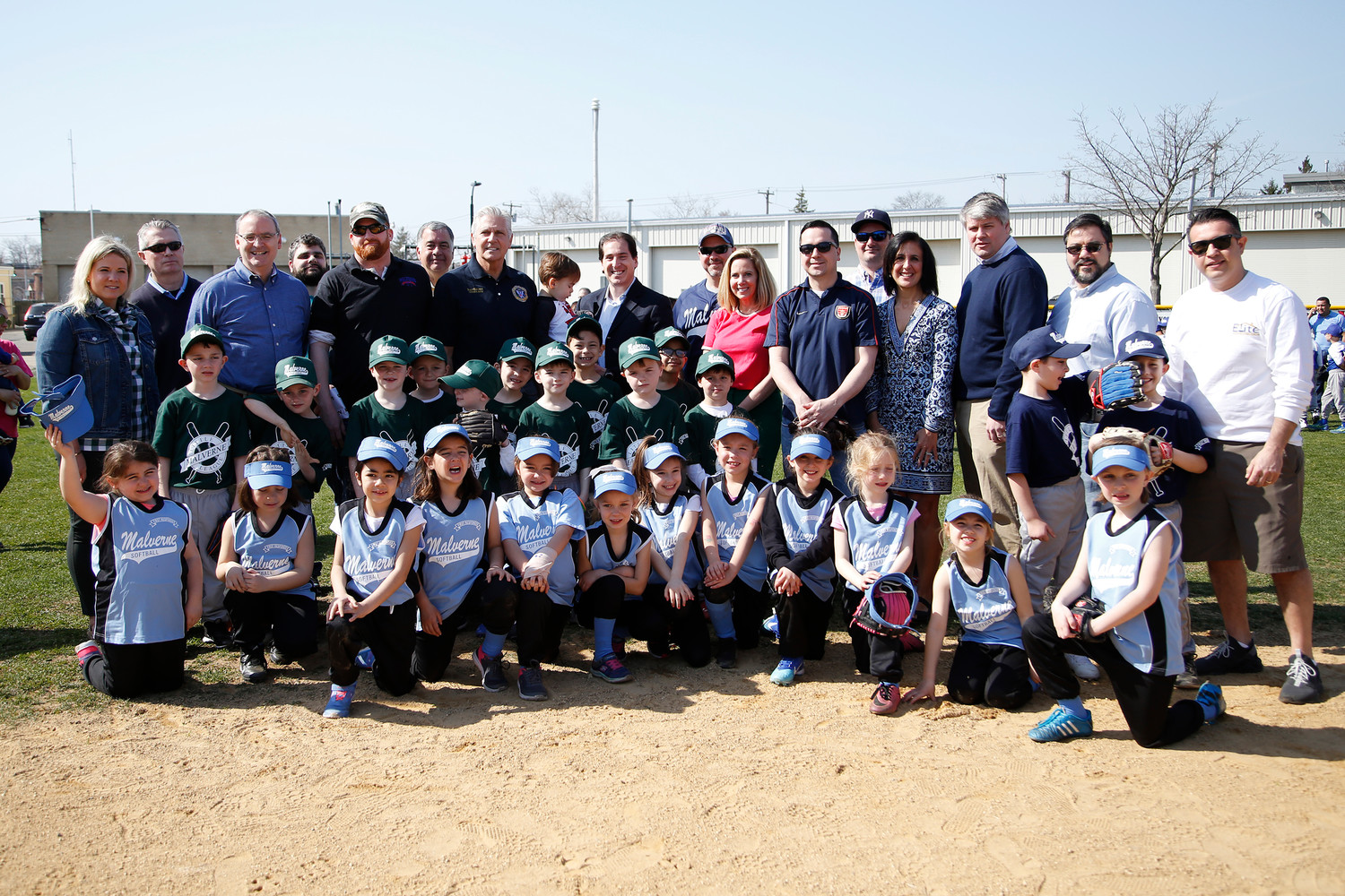 County and state officials accompanied children at Malverne Little League's Opening Day ceremony on April 14.