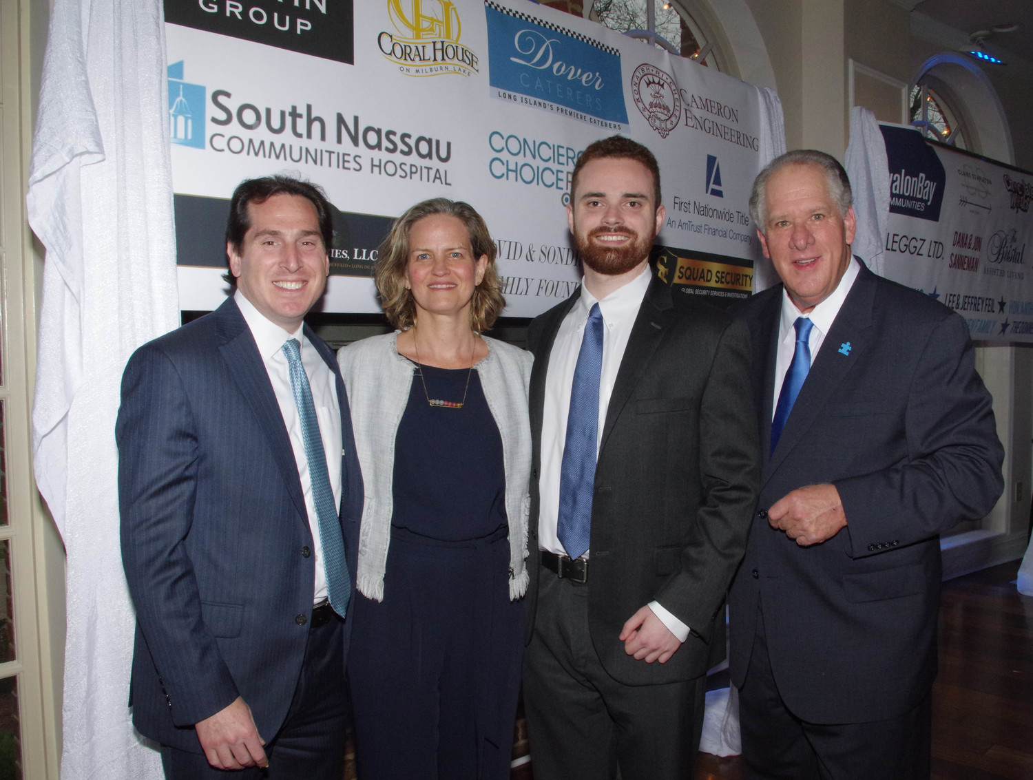 State Sen. Todd Kaminsky, left, Nassau County Executive Laura Curran, resident Sean Culkin, who was presented with the Courage Award and Tony Cancellieri, co-founder of RVC Blue Speaks.