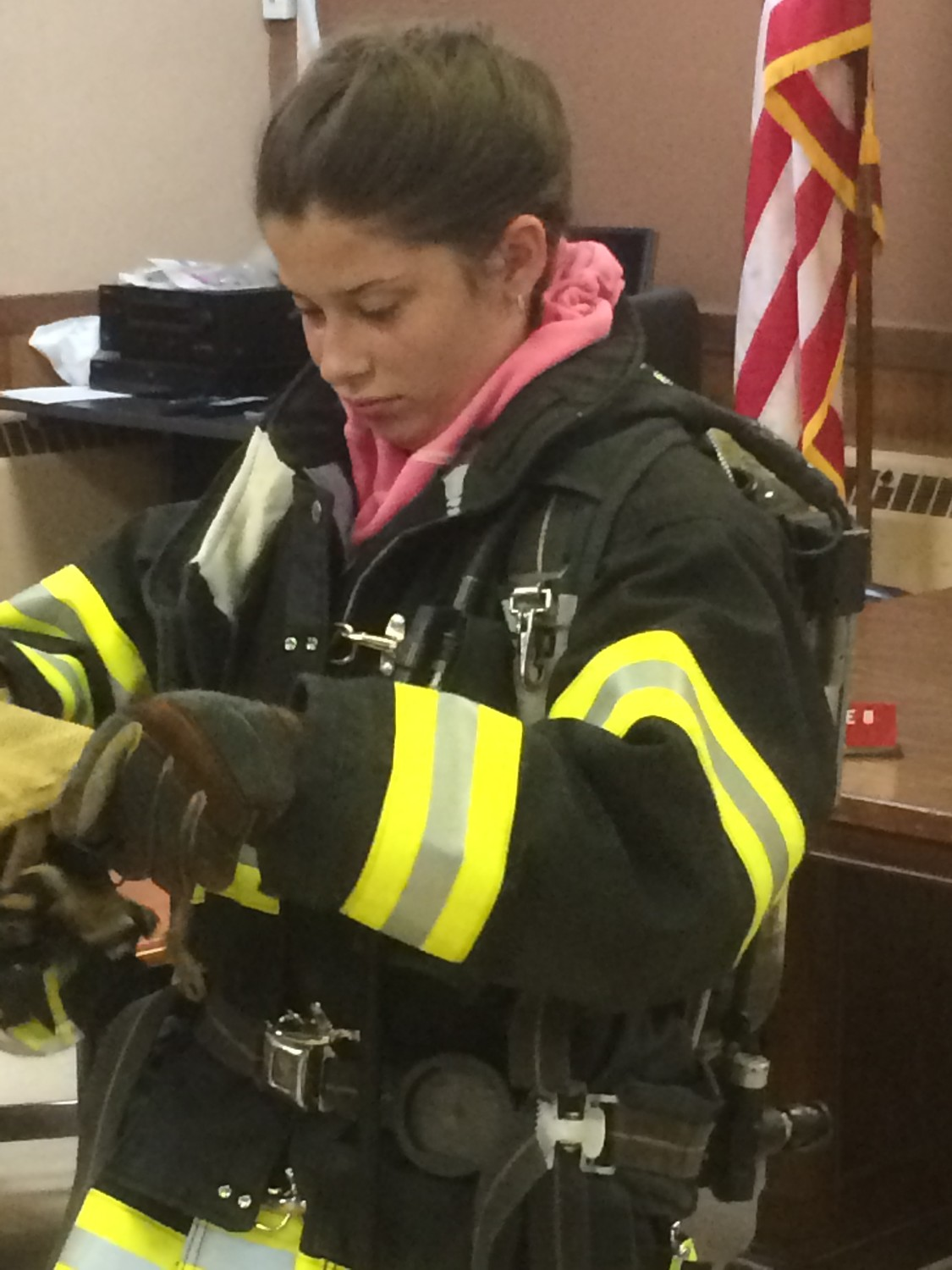 Erika Brancato tried on official firefighter gear at her first training session with the Rockville Centre Junior Fire Department in 2015.