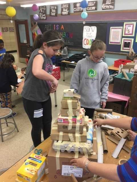 Students worked with their mothers to create a structure from ancient times.