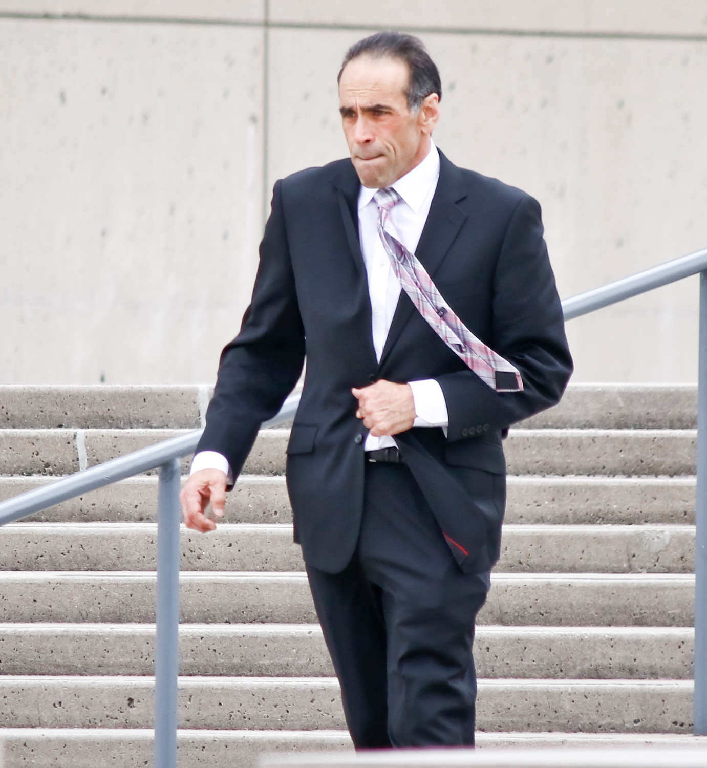 Dr. Michael Belfiore walked out of U.S. District Court in Central Islip on Tuesday. He is on trial for allegedly overprescribing opioids and causing the overdose deaths of two men, and was implicated, but not charged, in the death of another.