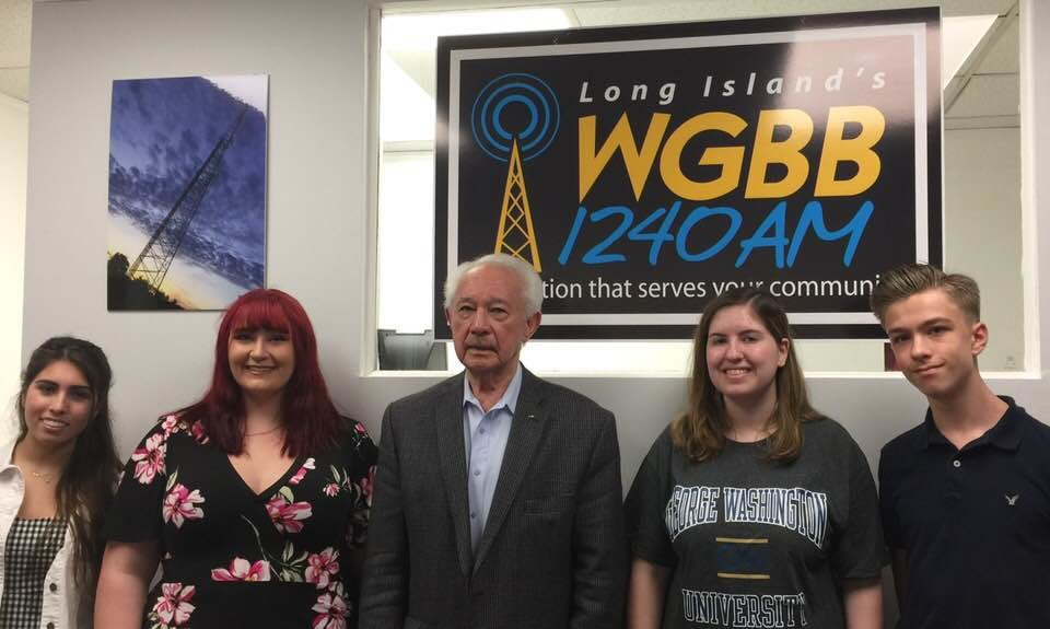 Bellmore-Merrick Central High School District students Josephina Bonura, left, Anna Kirby, Kara Vecchione, and Justin Dynia joined radio host Lou Telano, center, on April 14 to discuss the student-led anti-gun violence movement.