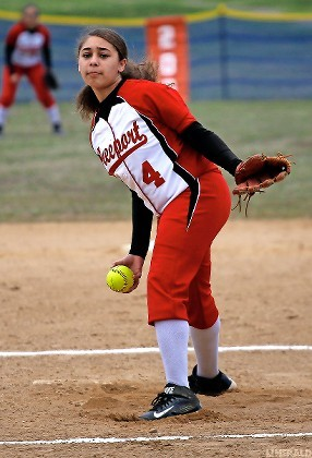 Naggalie Cruceta is handling the pitching workload for the Lady Devils and blasted two homers in the same inning last Saturday to lead a 26-14 win over Roslyn.