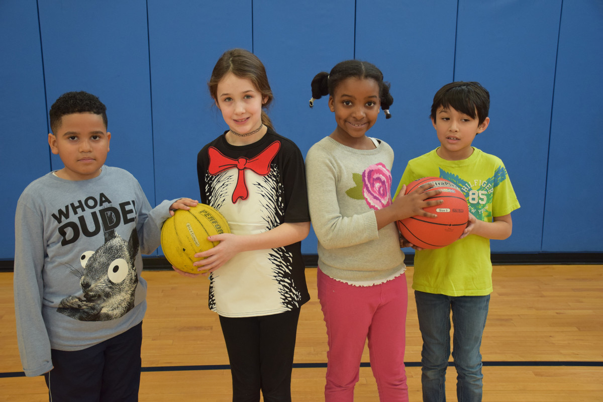 Students teamed up on the basketball court.