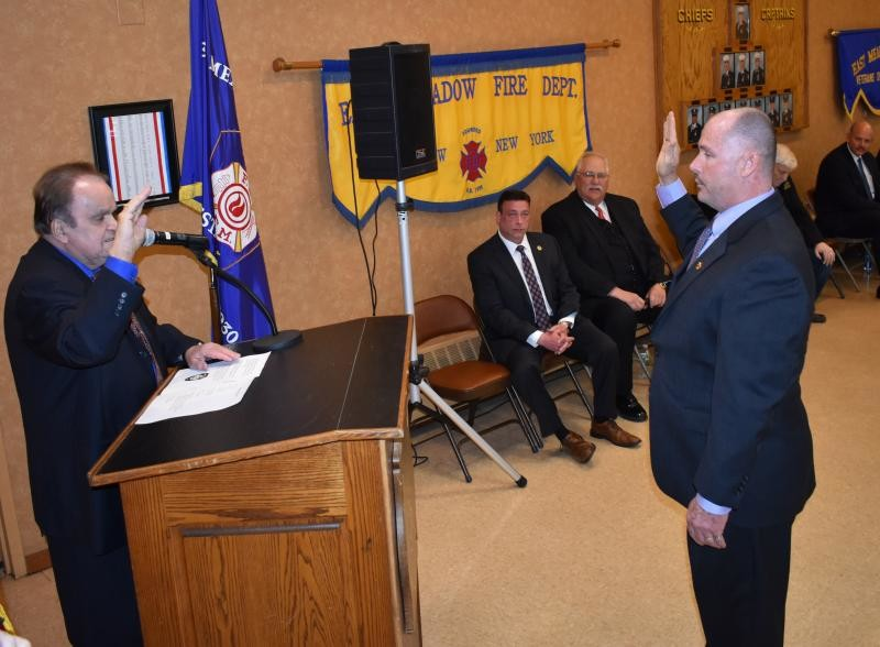 Philip Fertitta, right, accepted the Oath of Office from Commissioner James Surless as East Meadow's newly elected Chief of Department.