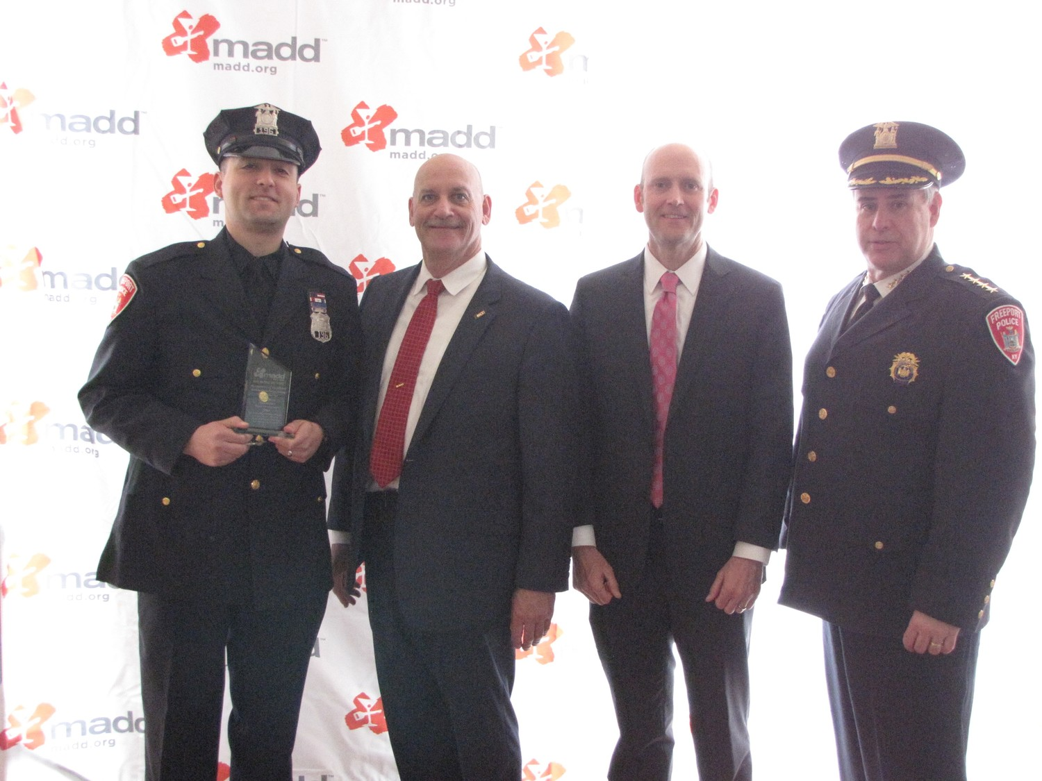 Freeport Police officer Alan Moreno, far left, accepted his award from MADD Executive State Director Richard Mallow, Chief Government Affairs Officer J.T. Griffin and Freeport Police Chief Miguel Bermudez.
