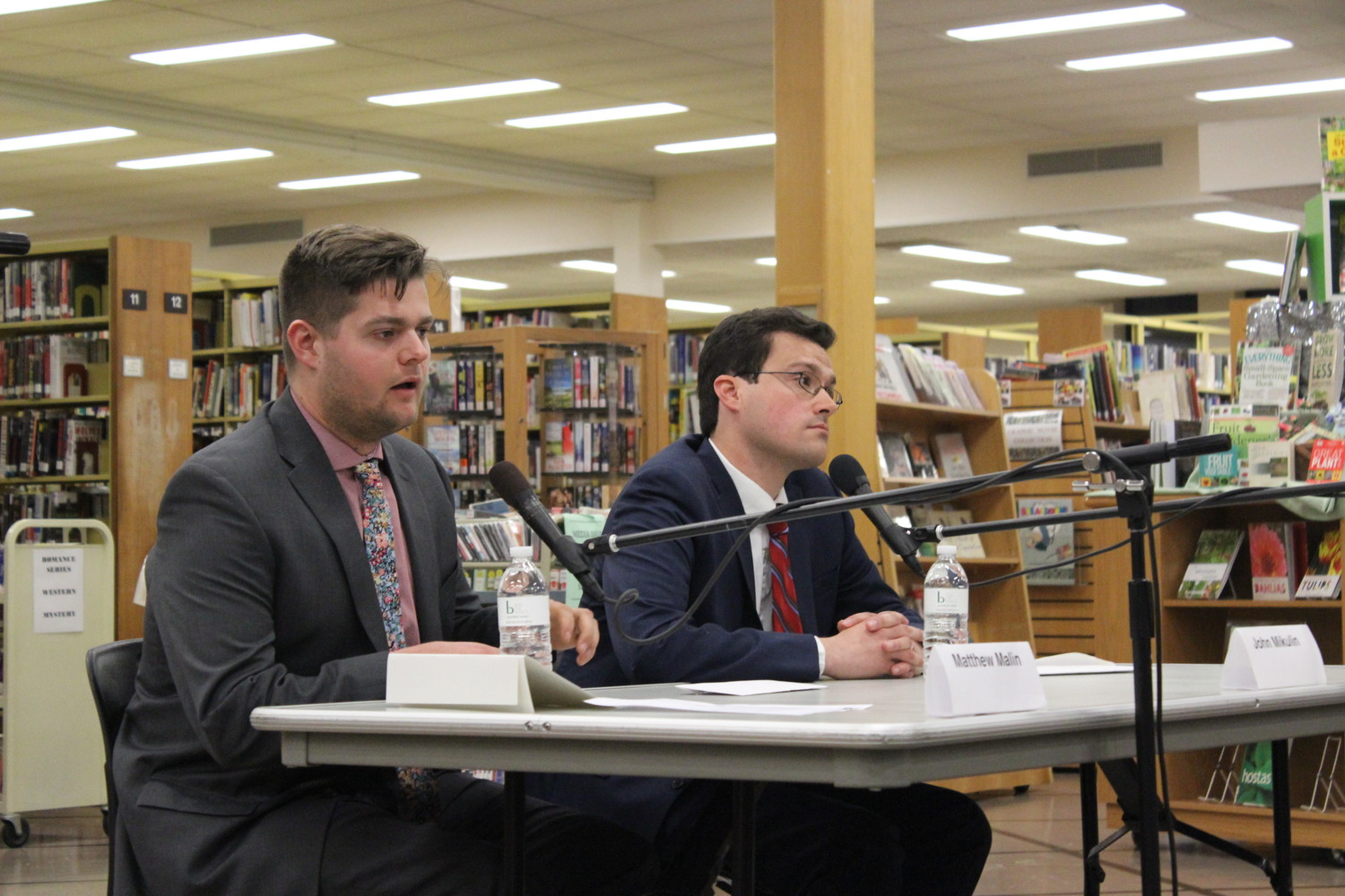 Matthew Malin, 25, of Seaford, left, and John Mikulin, 30, of Levittown, are the candidates in an April 24 special election to fill the seat in the State's Assembly 17th District. Both men addressed the concerns of district residents at a public forum held by the League of Women Voters at the East Meadow Public Library on April 12.