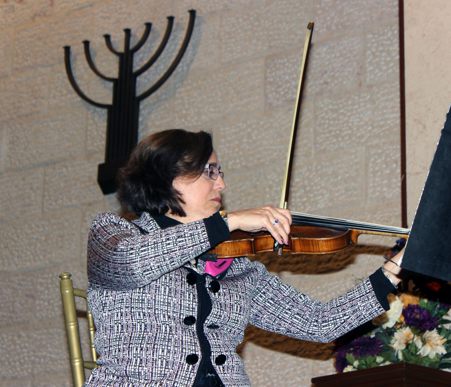 Geri Kushner played a restored viola in a string quartet at the East Meadow Jewish Center's Holocaust Remembrance Day service on April 11.