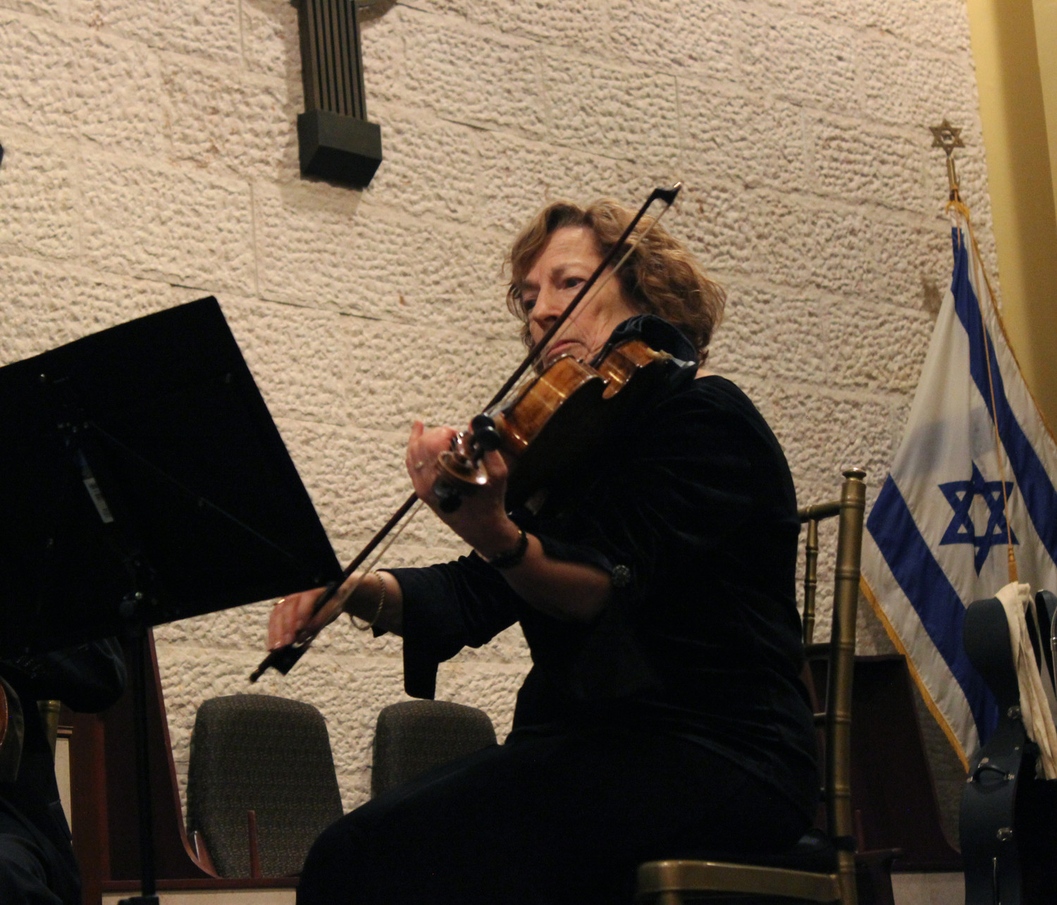 Sandra Herman played a violin that her father David had restored from the Holocaust.