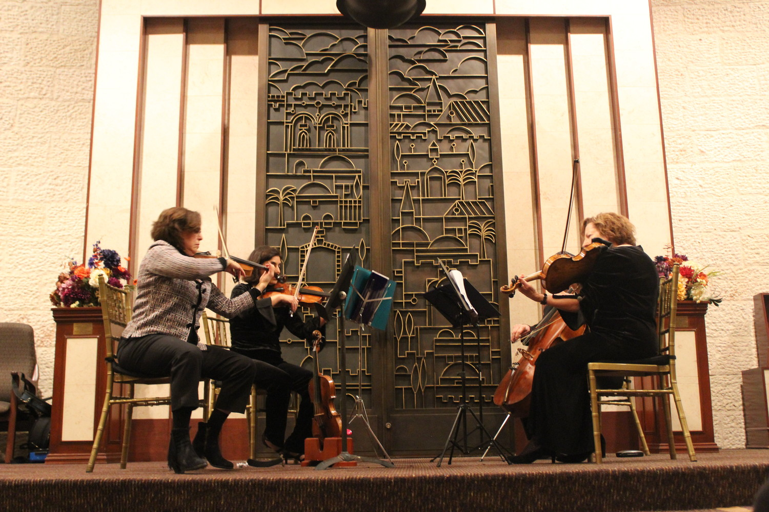 During the temple's Yom Hashoah service on April 11, congregants listened to a quartet play instruments that had been salvaged from the Holocaust.