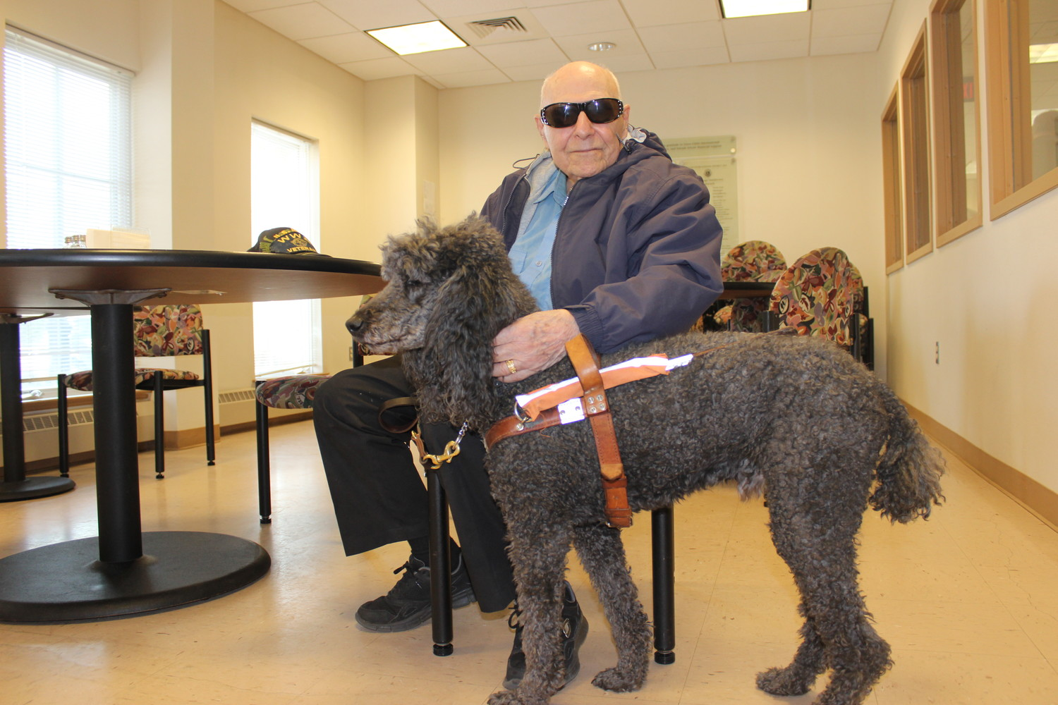 For the past five years, the organization has been one of the beneficiaries of the Chamber's biggest fundraiser of the year, Culinary Delights. Sy Lederman, 90, of Smithtown, spoke to the members of the Chamber to explain how the organization has benefitted him. He is pictured with his poodle Merlot.