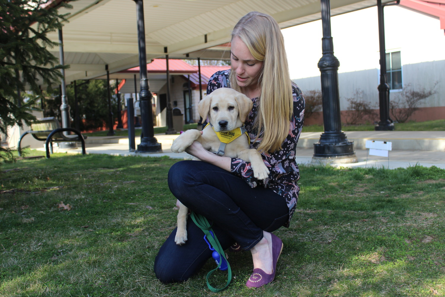 Allison Storck is one of the organization's puppy trainers. She is pictured with her dog Minnie.