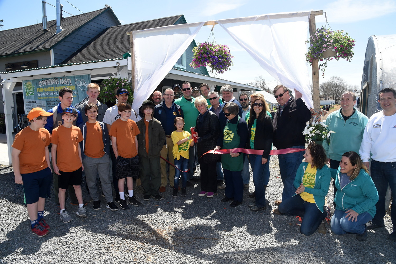 Malverne Mayor Patti Ann McDonald cut the ribbon to kick off the opening-day ceremony at Crossroads Farm on April 21.
