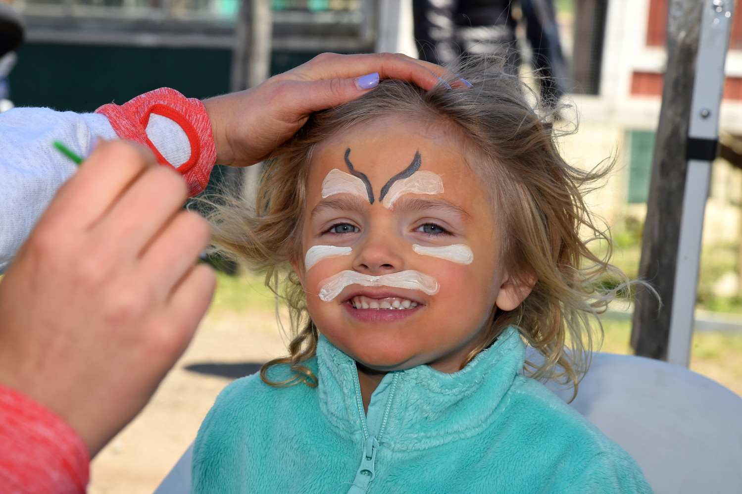 Senja Bullock, 5, was excited to get her face painted.