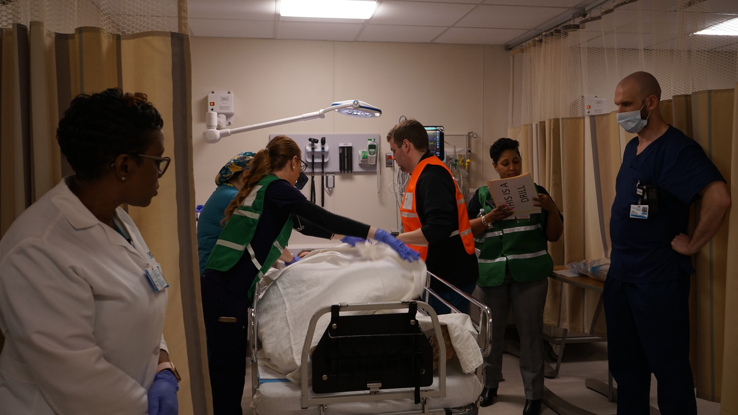 Nurses and doctors attempted to warm a patient whose body temperature was dropping due to blood loss.