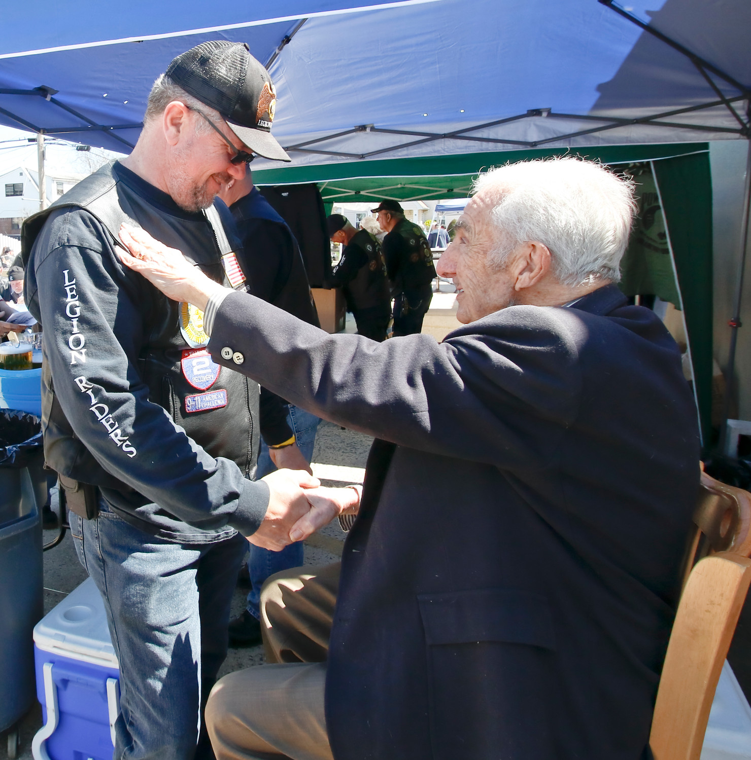 "Centenarian Frank Castronovo, right, greets Legion Riders' Director Peter Fulma. Frank's secret to making it to 100 is ""keep breathing."""
