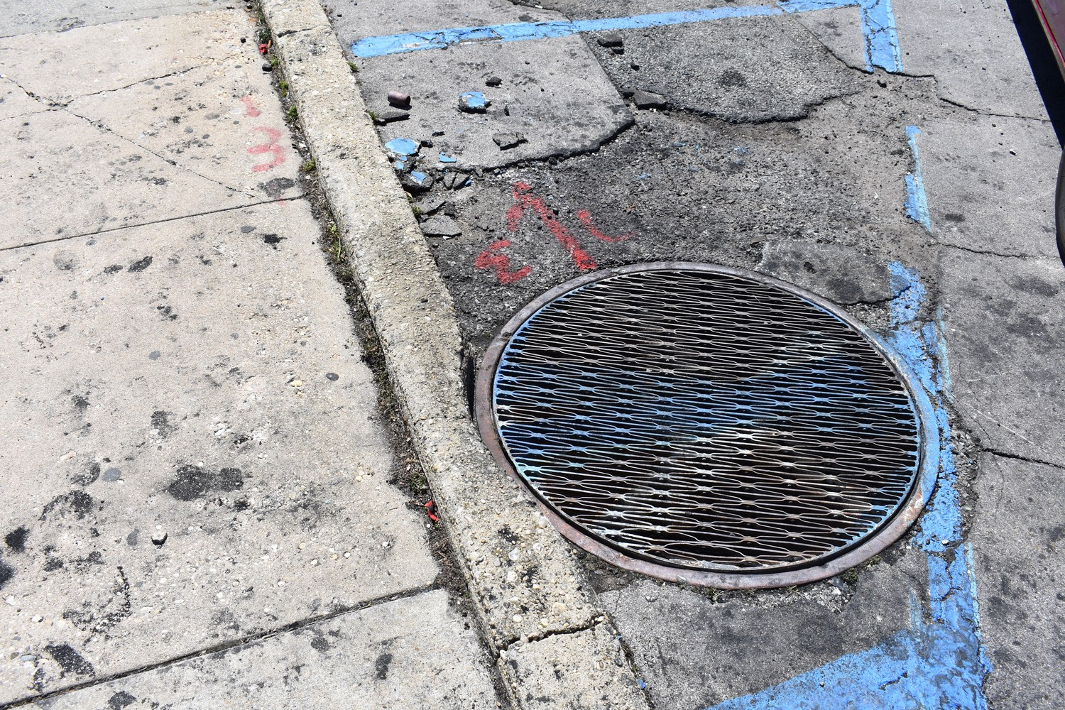 Firefighters opened this manhole to put out an underground fire on April 20.