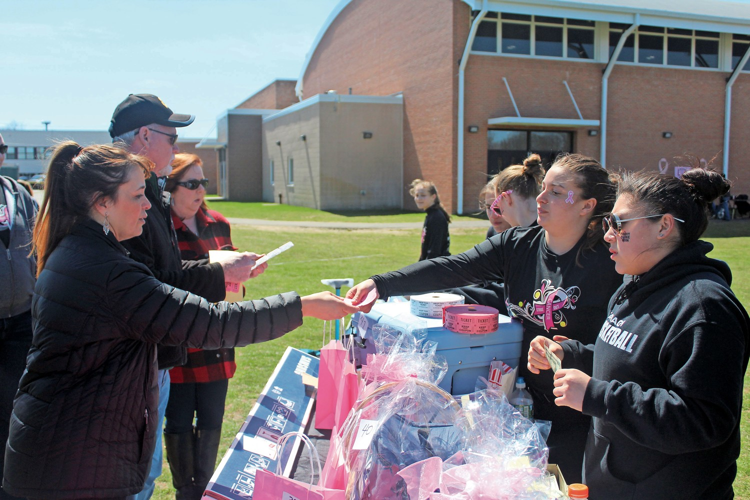 Members of the Wantagh and Seaford High School softball teams helped volunteers run the Strike Out Cancer fundraiser's 50/50 and regular raffles.