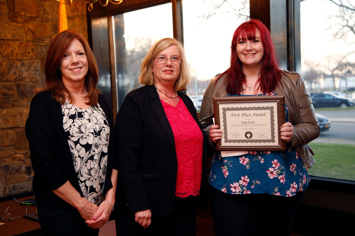 Anna Kirby from Calhoun was presented with the first place essay award by SSWA President Claudia Borecky, center, and Joan Carter.
