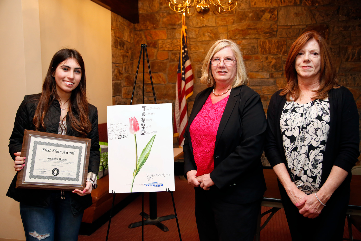 Josephine Bonura from Kennedy High School, won first place for her poster. She received her award from SSWA President Claudia Borecky, center, and Vice President Joan Carter.