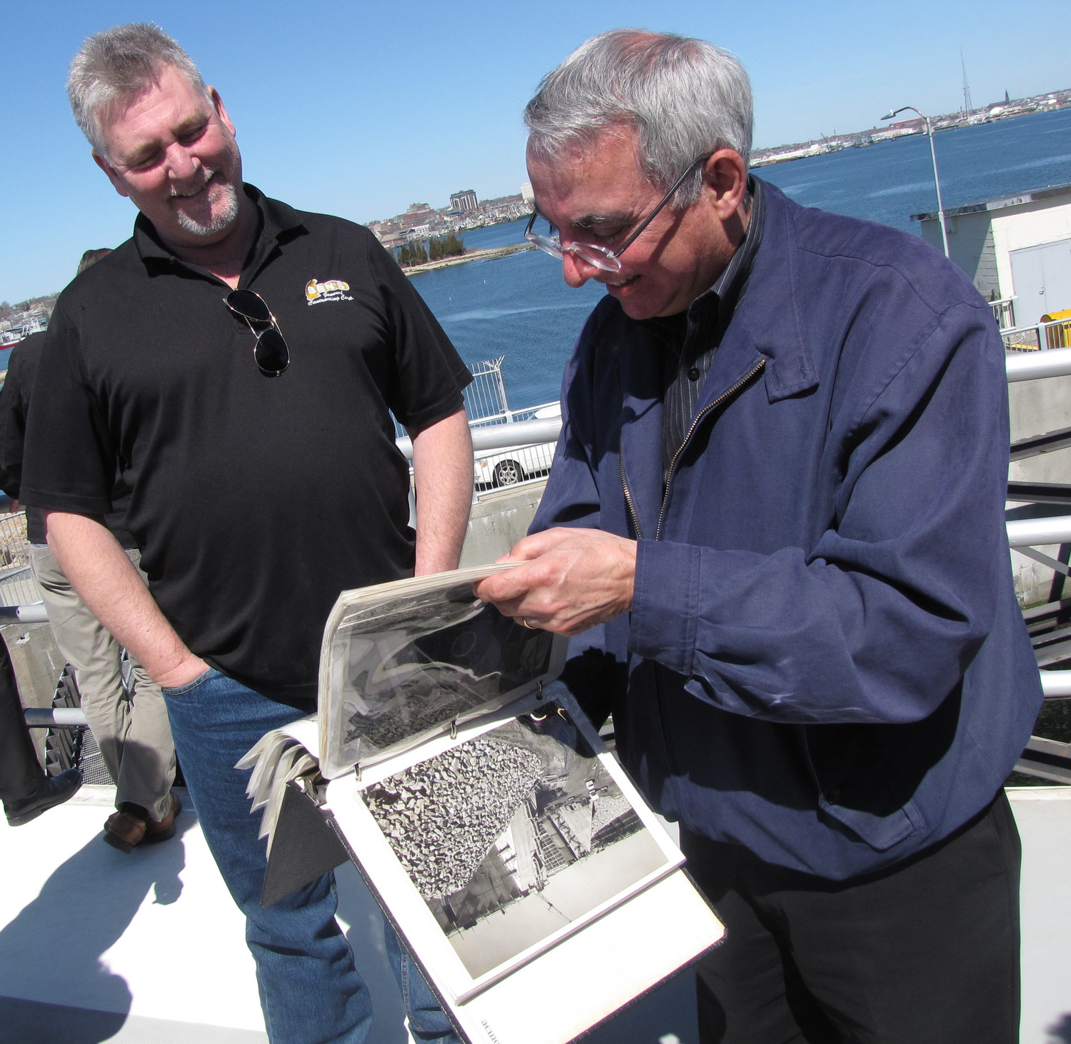 Freeporter Ben Jackson, left, looked through pictures of the early days of the New Bedford barrier with McDonald.