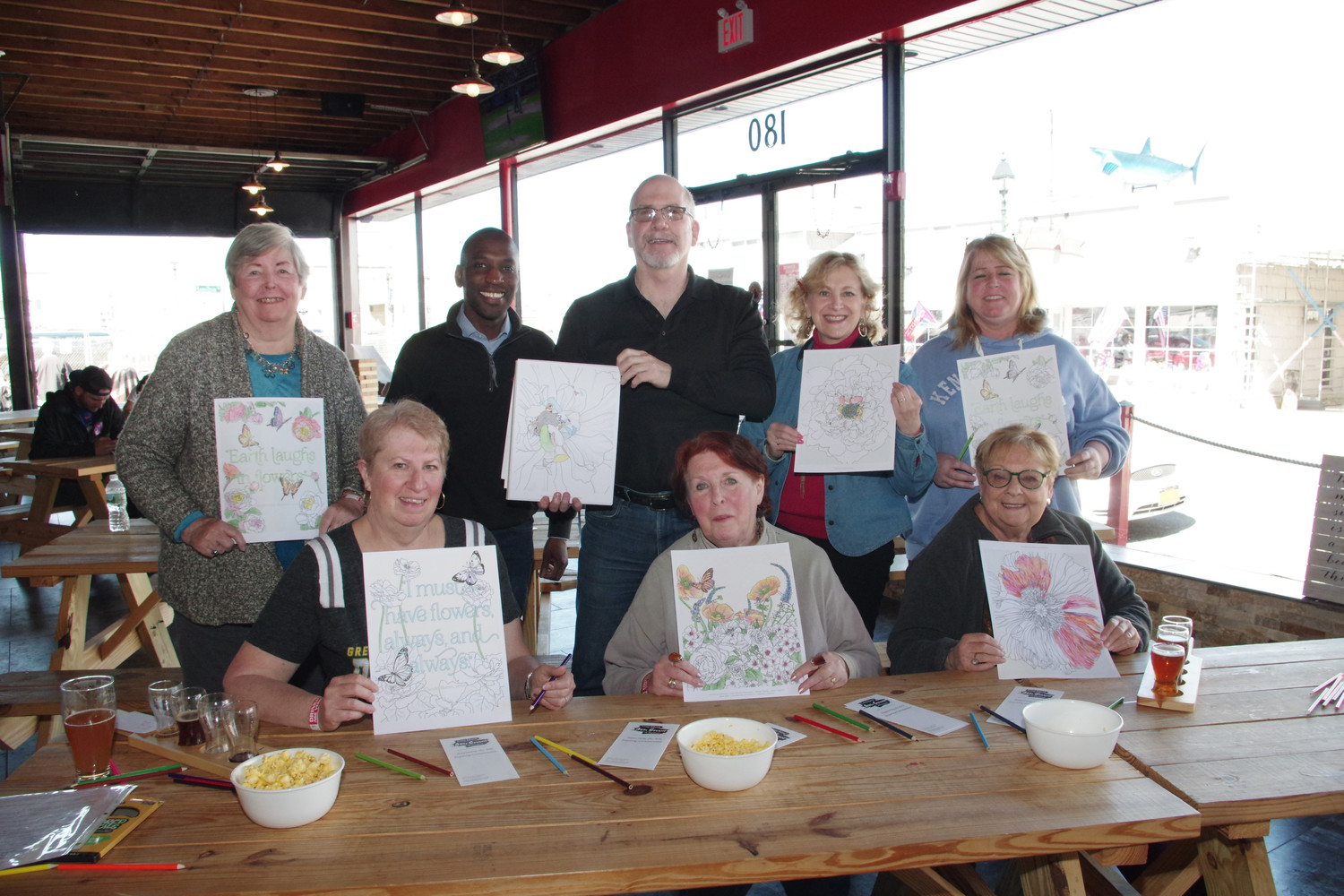 Long Island Arts Council at Freeport showed their finish coloring pages during the fundraiser at the BrewSa Brewery, from left, Janet Gabler, Anthony Miller, Larry Dresner, Michelle Berger, Sharon Gabler, Diane Stratton, Lois Howes and Mirelli Taub.