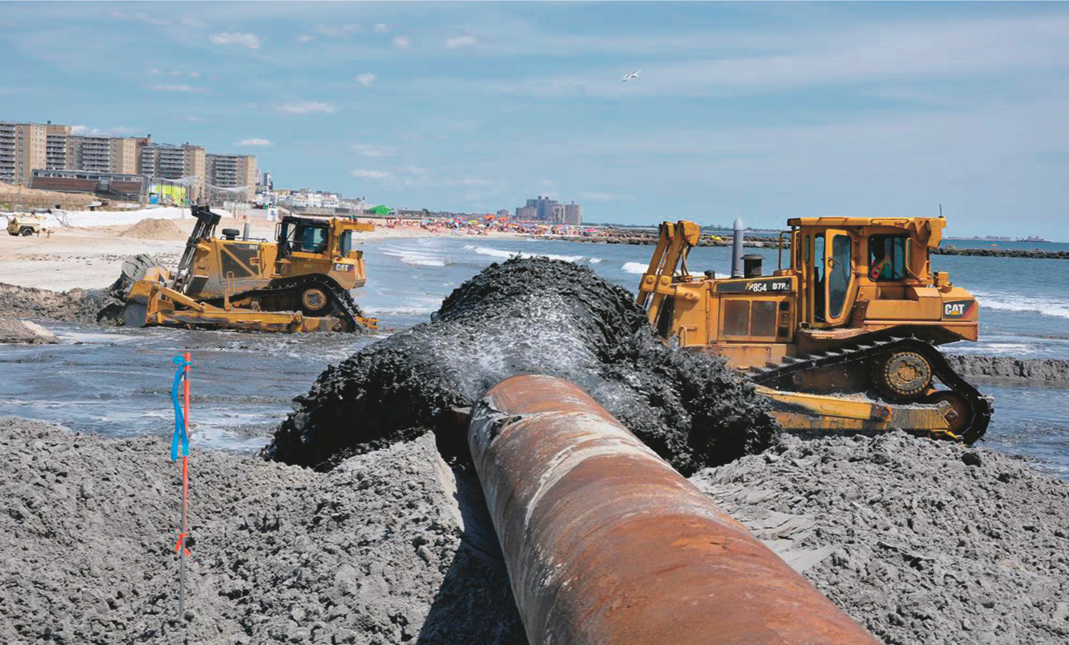 The Army Corps presented photos of a previous sand replenishment project in Rockaway Beach in 2013 that showed the process of hydraulically pumping sand onto the beach.