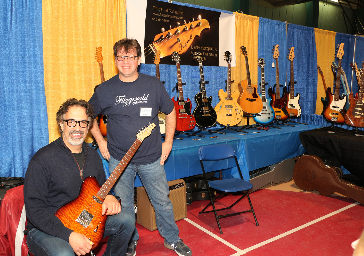 Larry Fitzgerald of Fitzgerald Guitars, a local music instrument store of Wantagh was all smiles with Dennis DelGuardio an attendee of the Guitar Expo held on last Saturday and Sunday at the Freeport Recreation Center.