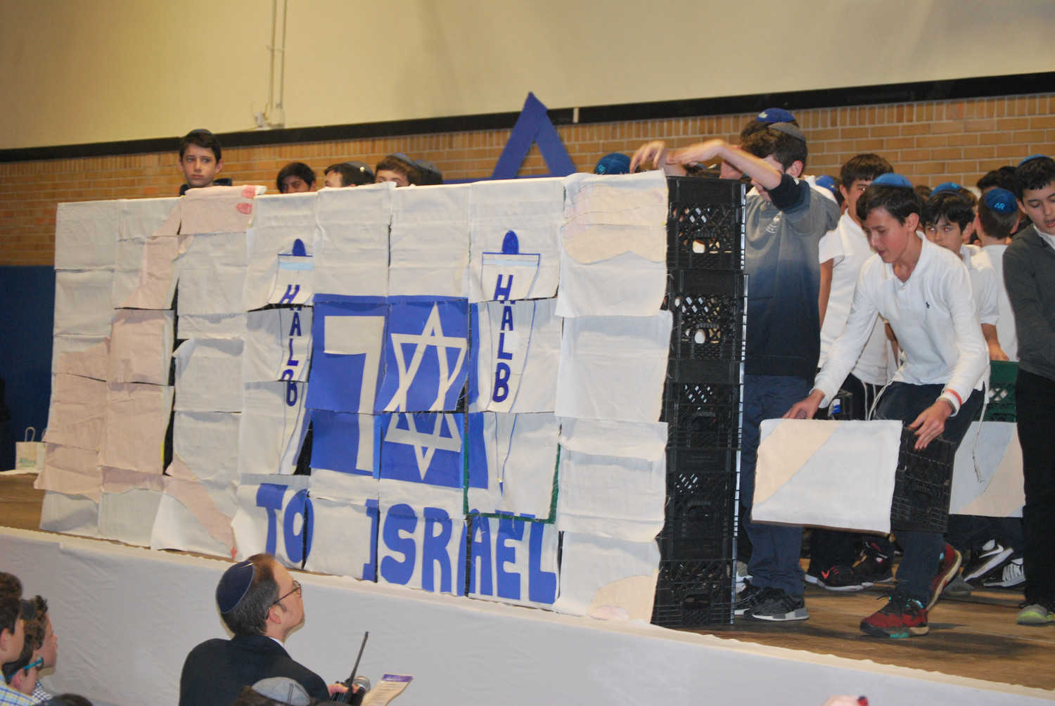 The walls of Jericho, the Wailing Wall and now the seventh-grade boys built a wall of crates to mark Israel's 70th anniversary.