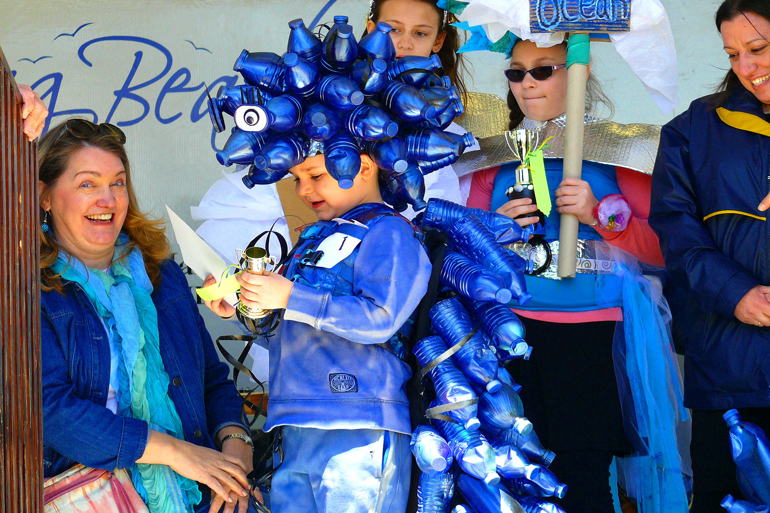 Director of Development for the LBNY-Arts Council Elizabeth Connolly awarded Lorenzo Herman a prize for his creative sea creature costume on Sunday at the Jellyfish Jamboree Earth Day celebration.