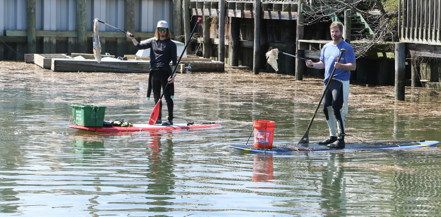 John Barnas, left, and Mark Davy helped remove debris and litter from the Canals at the annual Canal Cleanup organized by the Surfrider Foundation Central Long Island Chapter on April 21.