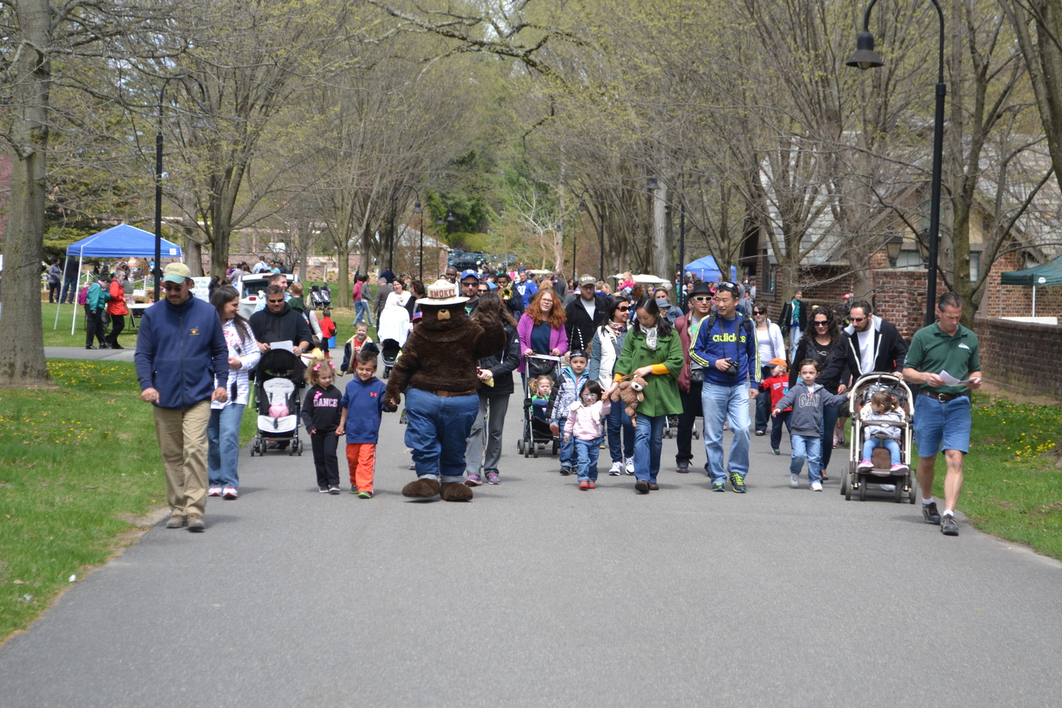 Smokey Bear leads the way at Planting Fields Aboretum's Arbor Day Festival.