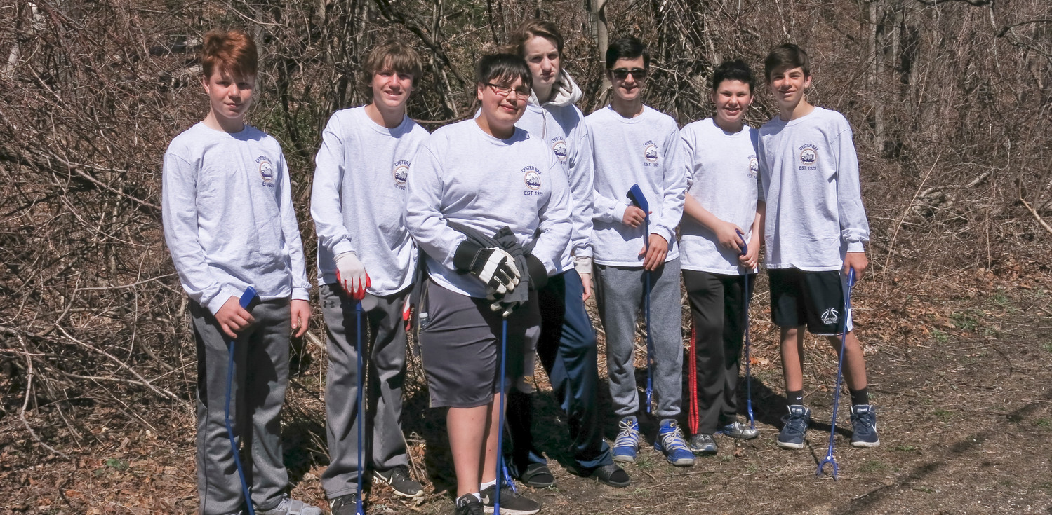 Seven boys from Oyster Bay High School spent Sunday morning cleaning up the garbage they were tired of seeing in their community.