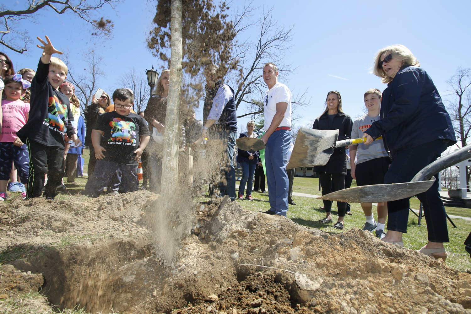 Children and elected officials helped to plant a white oak sapling in Morgan Memorial Park on Earth Day in honor of Marguerite Suozzi, a former first lady of Glen Cove, the mother of U.S. Rep. Tom Suozzi and a longtime supporter of the park.