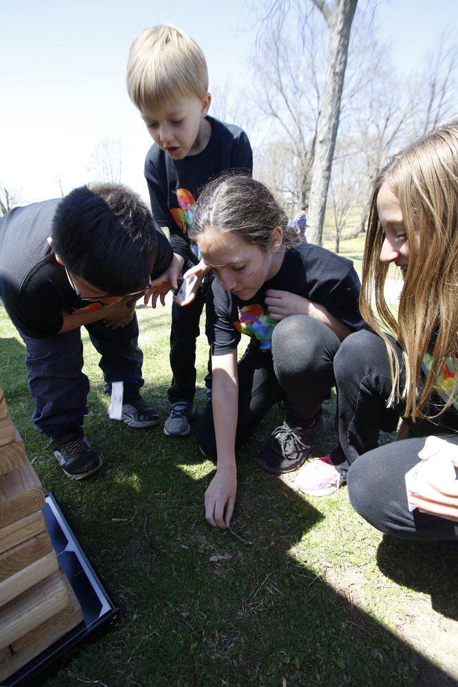 Saving an earthworm from a teetering Jenga tower was an important mission. Panagiotis Karathanasis, far left, Joey Ciampi, Sophia Karathanasis and Jaida Ciampi moved the worm to a safer area by the tree.