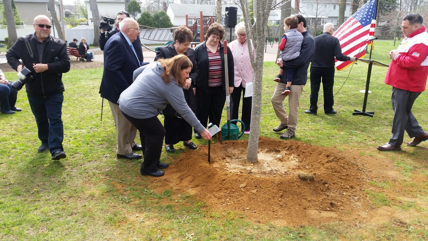 Family members of Malvernite Peter Zullo, village officials and local politicians gathered as Tree and Beautification Committee Chairwoman JoAnn O'Brien unveiled his plaque.