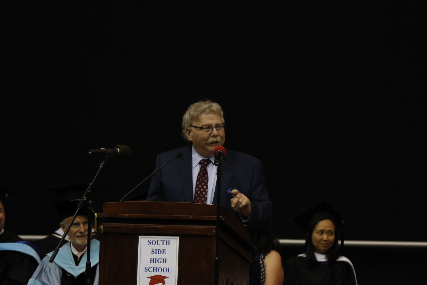 Mark Masin, pictured at last year's South Side High School graduation, decided not to run for re-election after 15 years on the Board of Education.