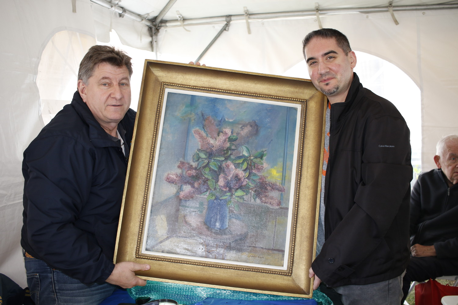 Richard Vardaro, right, showed off a painting by Nicholas Luisi, appraised by Philip Weiss, left, at $500 to $1,000. The painter was Vardaro's grandmother's cousin.