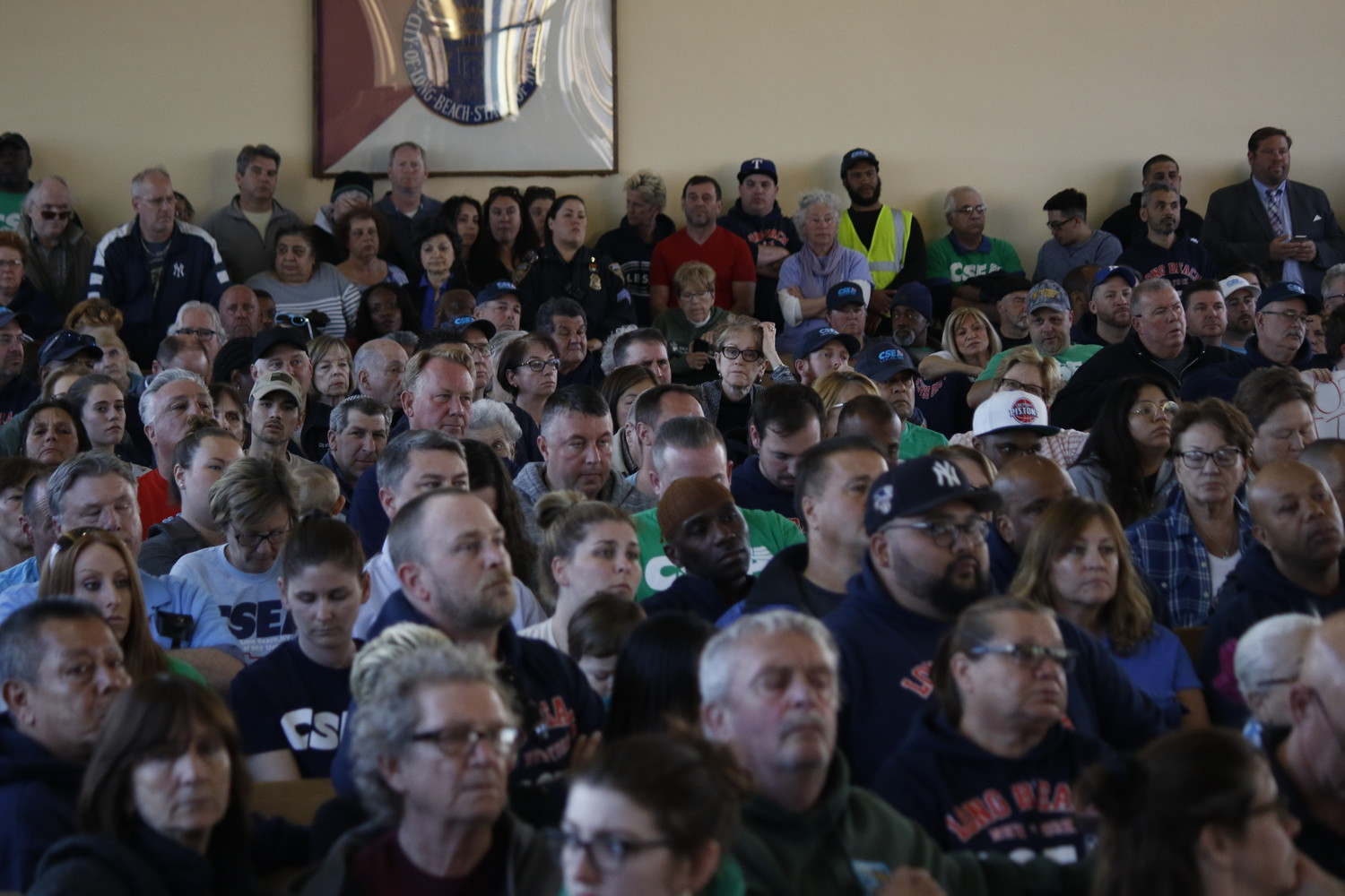 Hundreds of residents, union members and their supporters packed City Hall on Tuesday, where they criticized city officials over a possible tax hike, layoffs and service cuts.