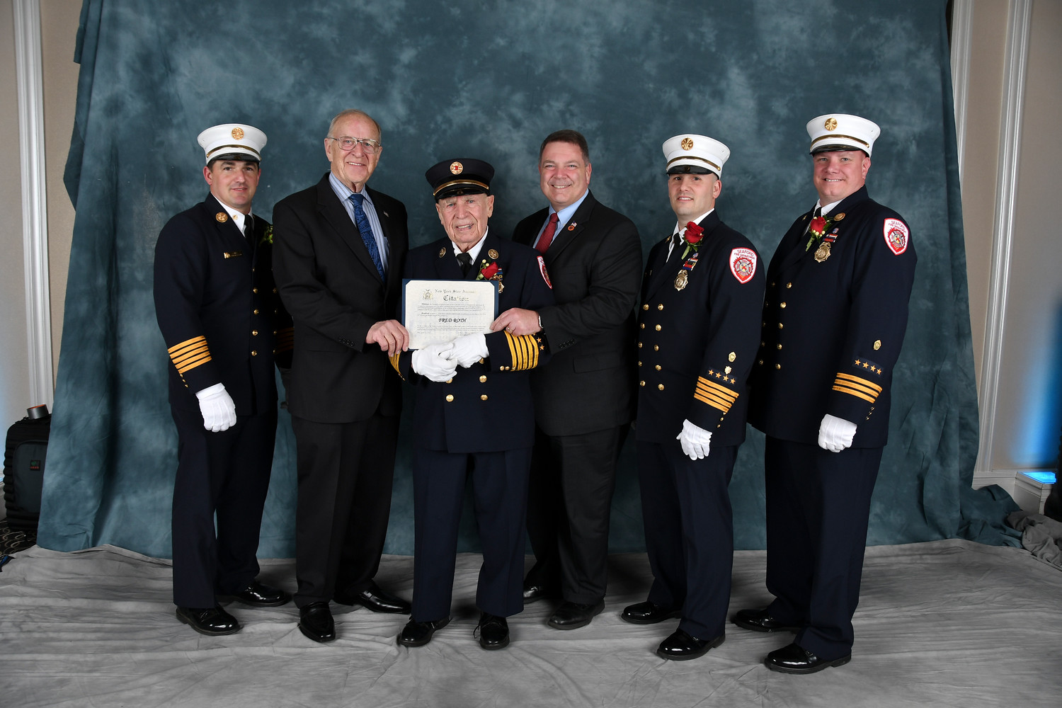 Fred Roth, 88, was honored at an April 21 installation dinner for seven decades of service with the Seaford Fire Department. From left, Chief of Department Keith Kern, Assemblyman David McDonough, Roth, Legislator Steve Rhoads, First Assistant Chief Michael Bellissimo and Second Assistant Chief Thomas De Haan.