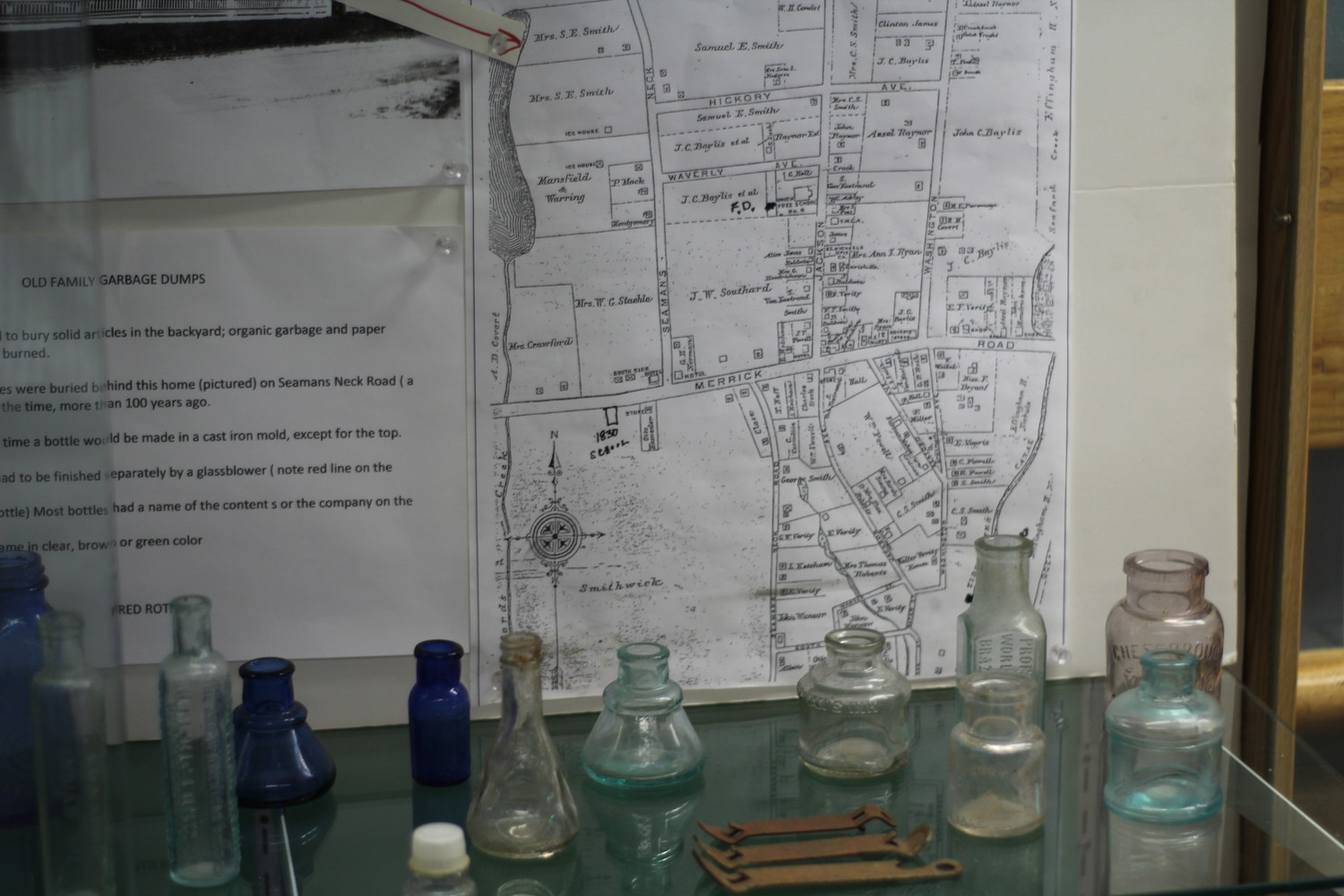 Roth's personal Seaford history collection has made appearances at the Seaford Public Library and Seaford Historical Society Museum. Here, Roth's century-old bottles and pots that he found buried behind a Seaford home are showcased at the library.