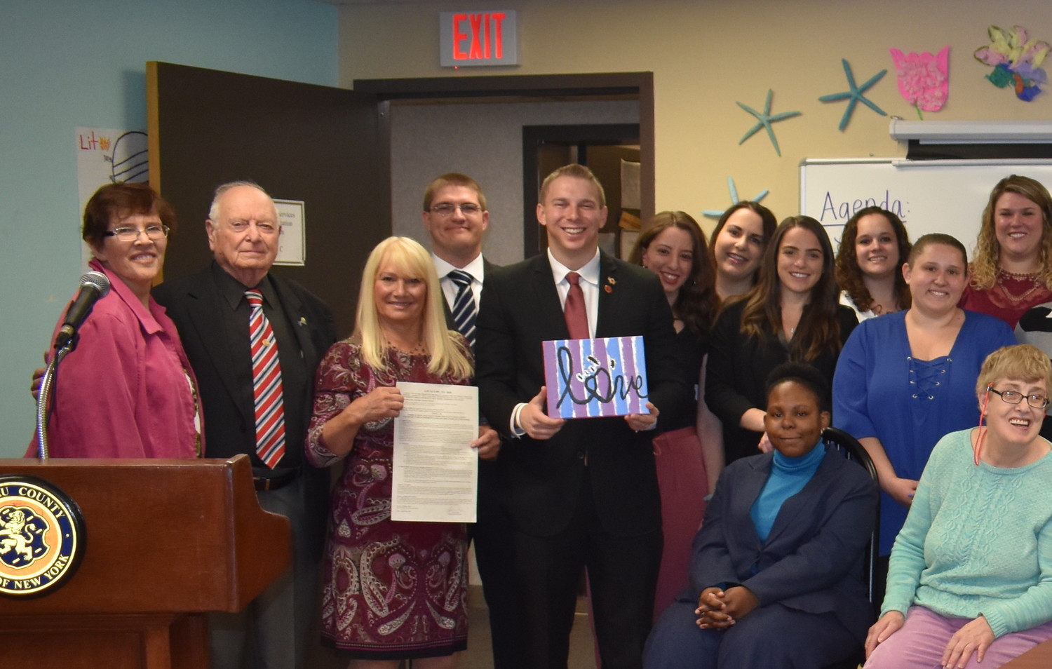 Supporters from the Mill Neck School for the Deaf's Day Habilitation Center, in Hicksville, attended the signing of County Legislator Josh Lafazan's first bill, which requires ASL interpreters at all emergency news conferences in Nassau County.
