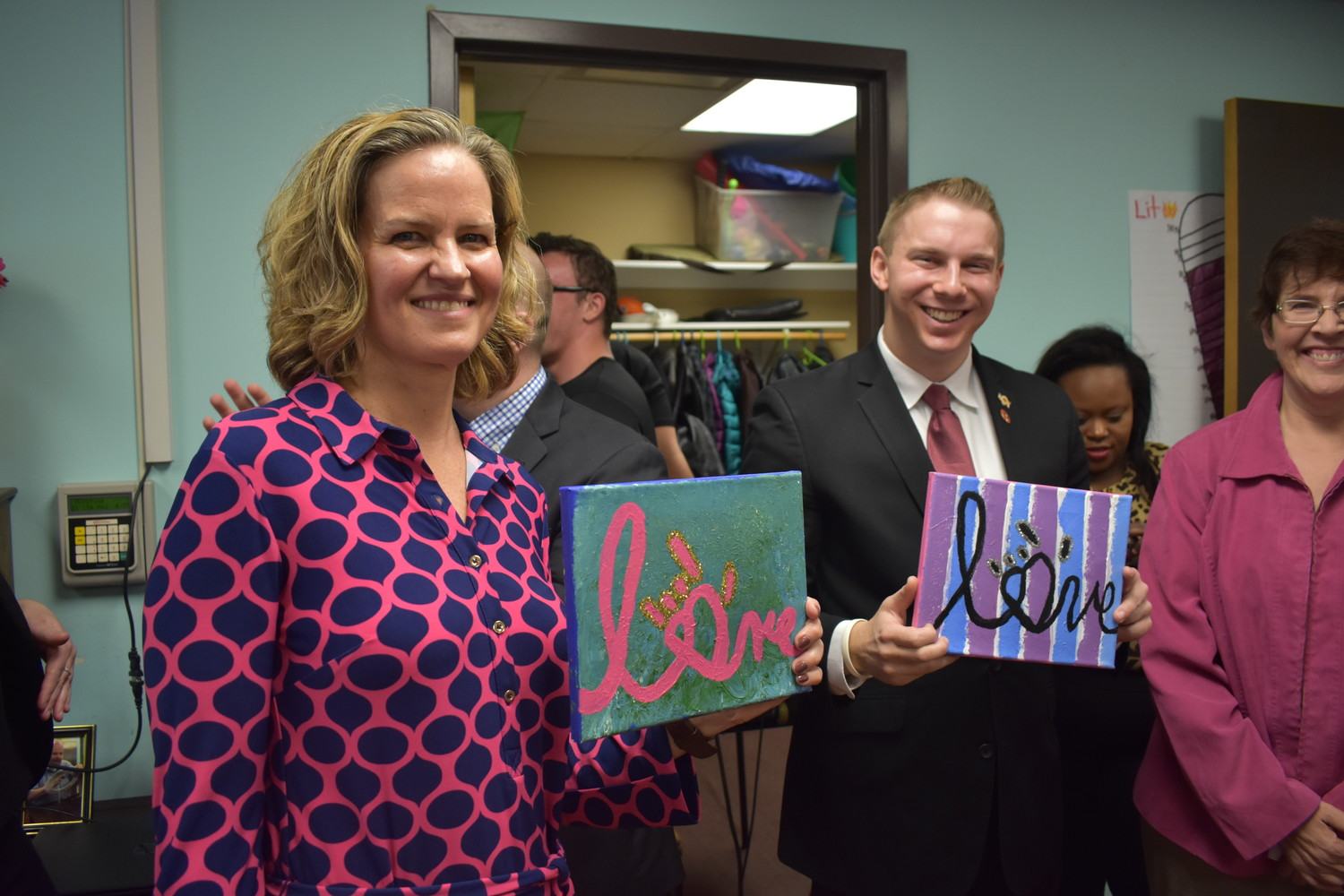 County Executive Laura Curran and Josh Lafazan received hand-painted canvases from Day Habilitation members.