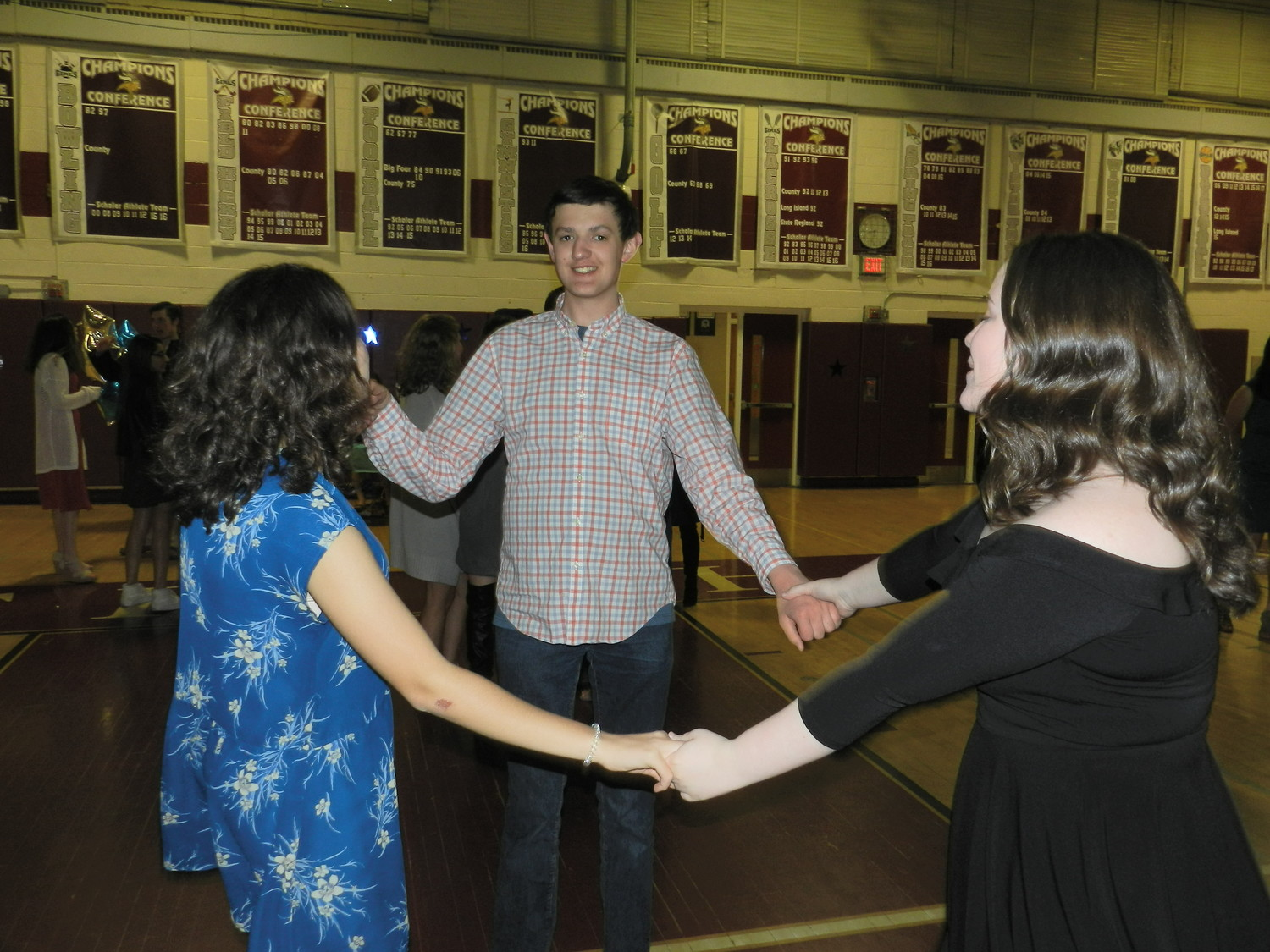 Students Emily Bilosi, Dan Purcell and Meagan Kearney cut a rug on the dance floor.