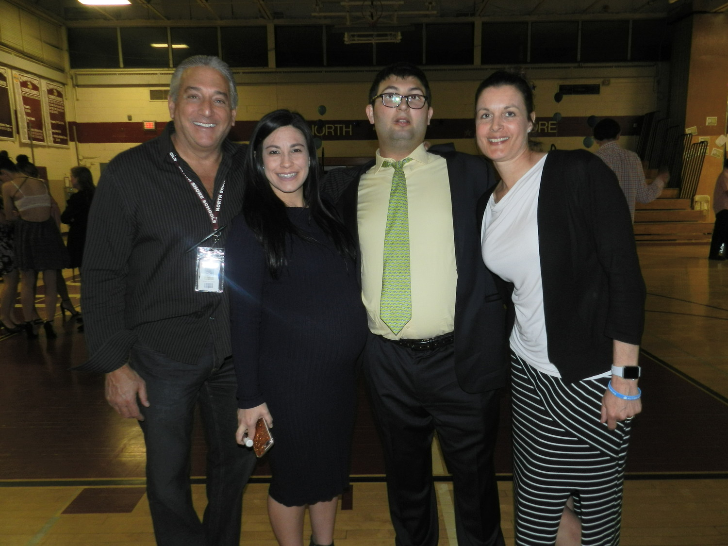 Life Skills aides John Vigliotti, Nicole Langone and Lisa Johanson were happy Sam Goldman, who will graduate from North Shore this year, was there to enjoy the dance.