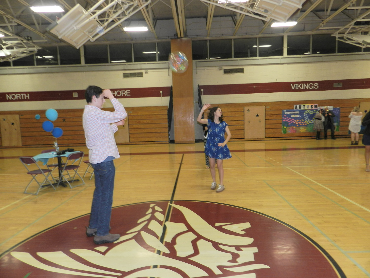 Dan Purcell and Emily Bilosi spiked up a storm with a beach ball at the Dance for Autism.